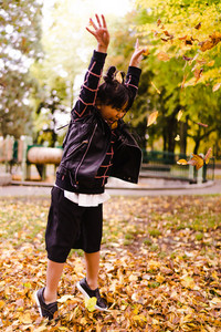 Young Asian girl playing with leaves