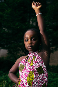 Young Black girl with fist in air for Black Power