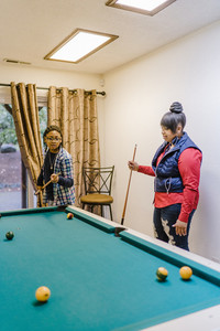 young children enjoy a game of pool together