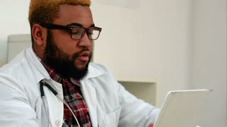 African American doctor giving consultation via tablet video call
