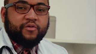 African American doctor talking to the camera