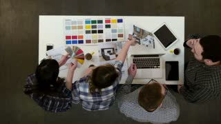 Architects and designers working and multitasking in the office