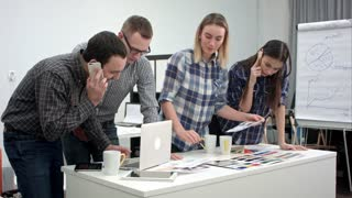 Architects and designers working in the office