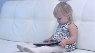 Baby using digital tablet at home