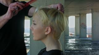 Beautiful blond woman gets a hairdress
