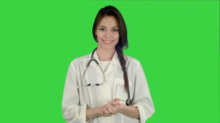 Beautiful female doctor with stethoscope smiling at camera on a Green Screen, Chroma Key