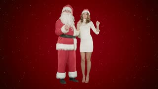 Beautiful happy woman dancing with Santa Claus on red background with snow