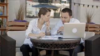 Business people discussing new project in coffee shop