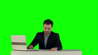 Business people Having Meeting Around Table with laptop on laptop on a Green Screen, Chroma Key
