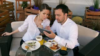 Business people in a restaurant using a tablet device