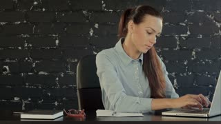 Business woman with notebook in the office