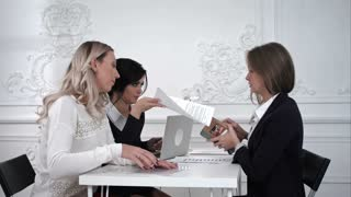 Business women receiving money in the office