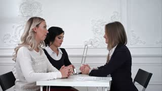Business women working and discussing together at meeting in office