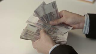 Businessman counts money in hands
