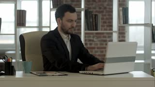 businessman finished work in front of a laptop