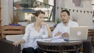 Businessman tearing up a document, contract or agreement on business meeting in cafe