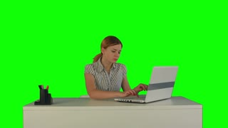 Businesswoman working on laptop on a Green Screen