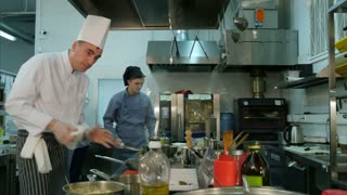 Busy cooking process in the professional kitchen