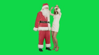 Christmas happy smile girl dancing with Santa Claus on a Green Screen Chrome Key