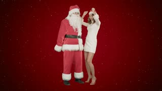 Christmas happy smile girl dancing with Santa Claus on red background with snow