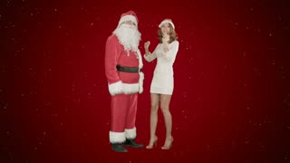 Christmas woman with santa claus dancing on red background with snow