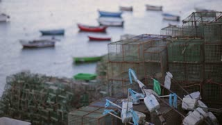 colourful cascais fish boat marina, evening, fishing nets