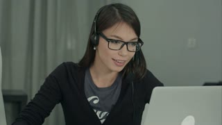 Confident and beautiful customer support operator working in call center