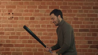 Dangerous man with baseball bat ready for fight