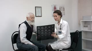 Doctor explaining x-ray results to patient.