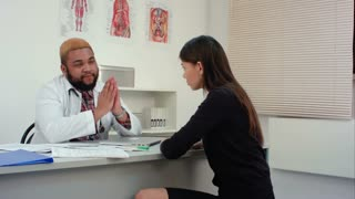 Doctor giving bad news to upset female patient