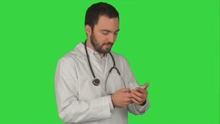 Doctor makes telephone call on a Green Screen, Chroma Key