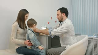 Doctor measuring blood pressure of a child in examination room