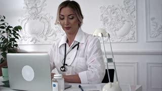 Female doctor explain patient's condition by smart phone