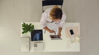 Female doctor using digital tablet to check patient's medical case in medical office