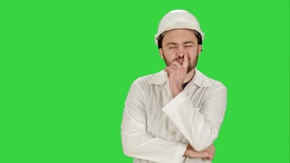 Frustrated workman in helmet over on a Green Screen, Chroma Key