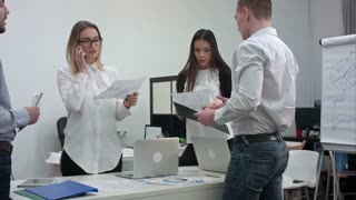 Group of office workers with diagrams preparing for business presentation