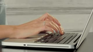 Hands of business woman with keyboard laptop