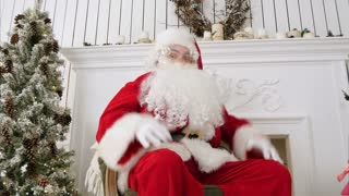 Happy Christmas Santa Claus showing thumbs up