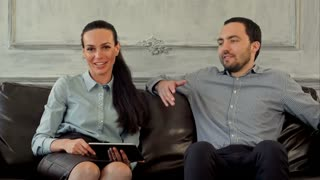 Happy couple on therapy session with family psychologist