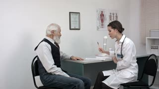Happy doctor and patient discussing over reports in clinic.