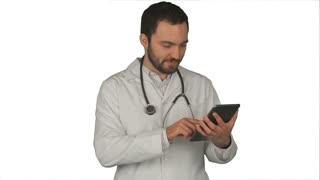 Happy doctor using digital tablet on white background