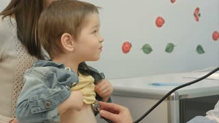 Hospital: Doctor Checks Heartbeat Of Young Boy