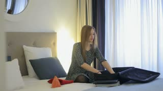 Incoming call stops process of packing a suitcase in hotel