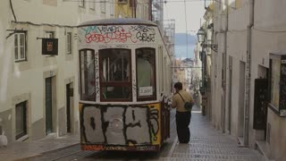 LISBON, PORTUGAL - SEP 15, 2015: Famous retro designed funicular in the Old Town street of Lisbon, Portugal