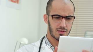 Male medical worker using digital tablet