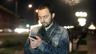 Man send text message by cell with confused expression on face
