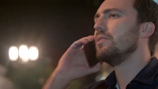 Man smokes and calling with his phone