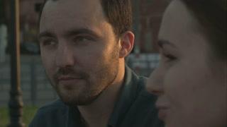 Man speaks to woman. Closeup