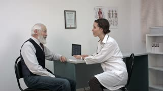 Old patient talkint to young female doctor.