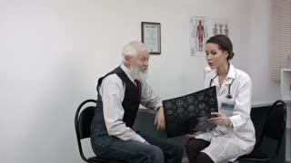 Patient smiling while doctor telling results of mri.